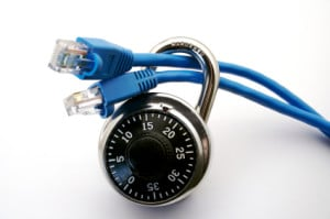 An ethernet cable is run through a lock. This can represent internet safety, virus, firewall or network protection.